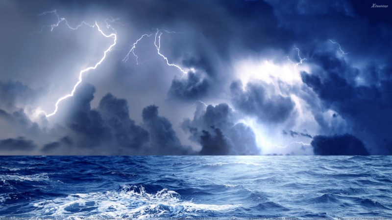 Name:  Storm-And-Blue-Lightining-At-Sea.jpg